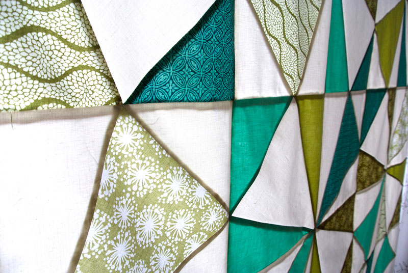 How I made a modern stained glass quilt with a quilt top and a large window | Suzy Quilts  - https://suzyquilts.com/stained-glass-quilt/