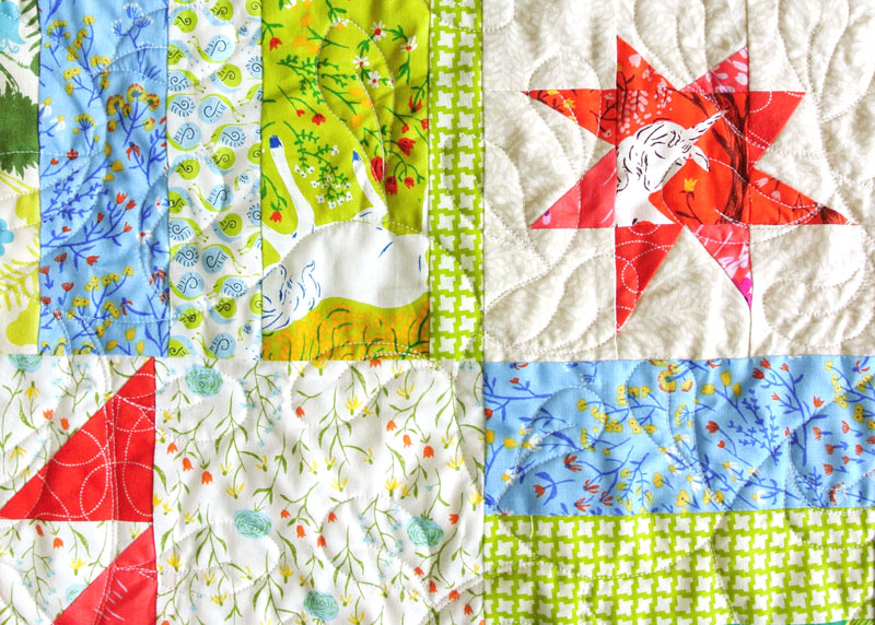 How to make a medallion quilt modern, including a brief history of medallion quilts | Suzy Quilts - https://suzyquilts.com/unicorn-medallion-quilt/