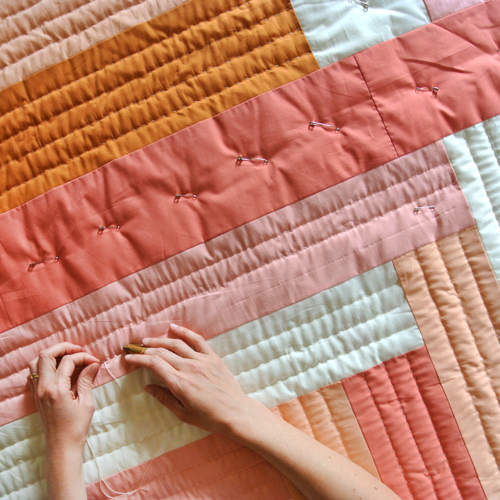 How to hand quilt in 3 easy steps! In this blog and video tutorial I'll list out all of the supplies you need and show you how simple hand quilting can be. Get the Maypole quilt pattern!