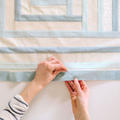 Hand quilting the Campfire baby quilt for sale