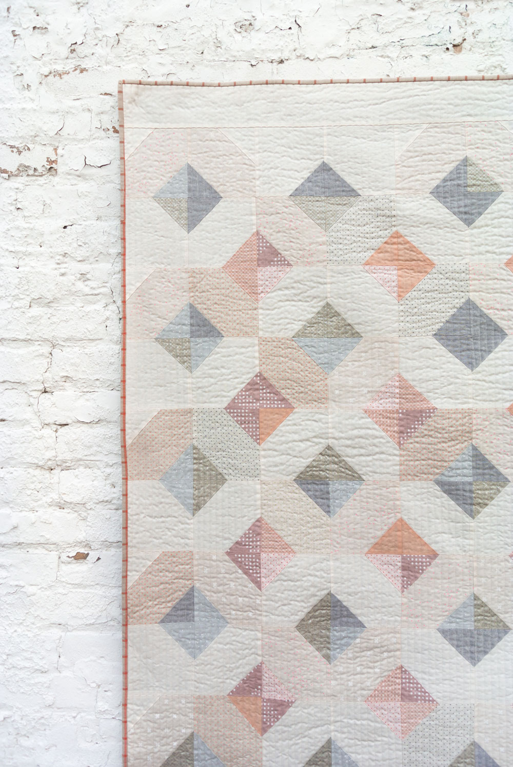 The Glitter & Glow quilt pattern comes in king, queen/full, twin, throw and baby quilt sizes. It's a simple beginner-friendly quilt pattern that is also scrap and fat quarter friendly!