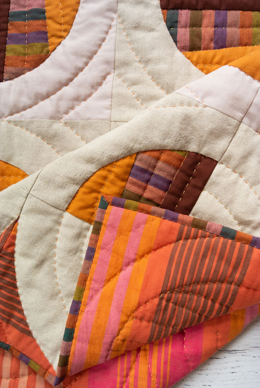 Modern Fans is a bold, modern quilt pattern that includes king, queen, twin, throw and baby quilt sizes as well as a video tutorial! This baby quilt uses lots of different subtle textures.