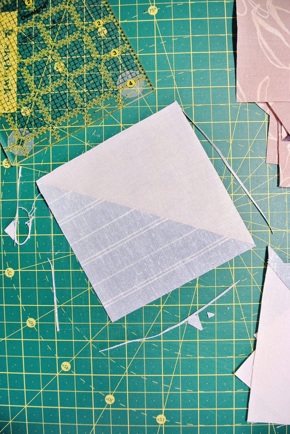 Check out these 3 must-have tools to make the perfect half square triangle. These tools and tricks are simple, inexpensive and easy to use. | Suzy Quilts https://suzyquilts.com/3-tools-to-make-the-perfect-half-square-triangle