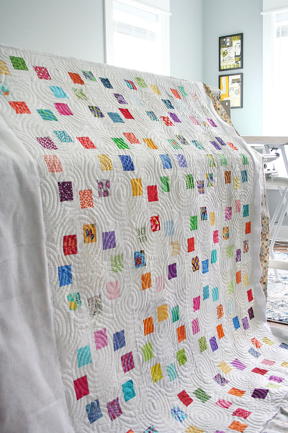 Do you have questions about hiring a longarm quilter? This in-depth guide answers all of those questions from fabric to price to turnaround time.