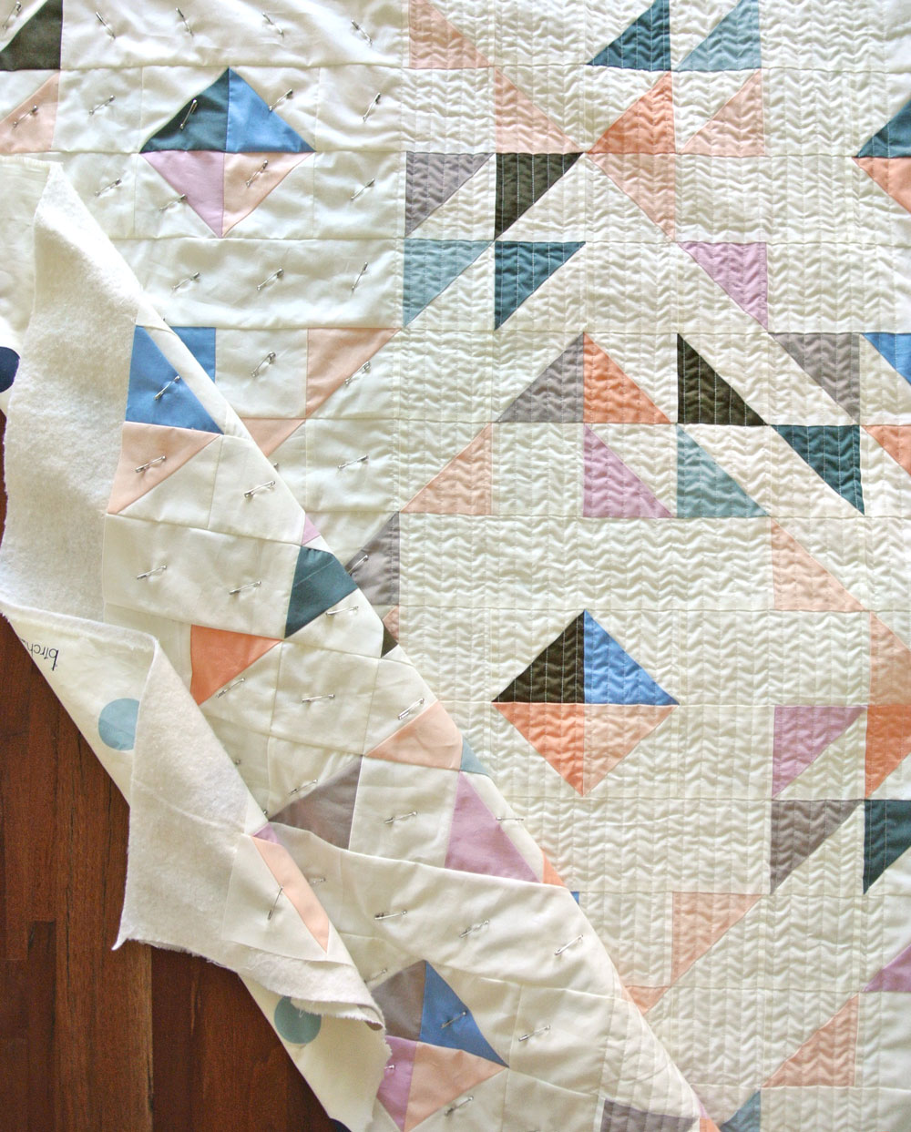 Learn the 6 simple steps to straight line quilting, or as some call it, matchstick quilting. This is a great beginner quilter tutorial! This is what happens when you don't quilt in the same direction – ugly tension waves in the fabric.