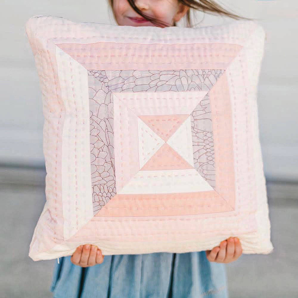 The Reflections Wall Hanging and Pillow extension pattern is a beginner-friendly modern design. These two projects are perfect for a fat quarter bundle or using up scraps!