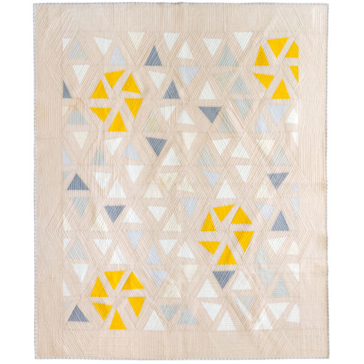A Beautiful modern flower quilt pattern to add some cute pom poms! The Perennial quilt pattern looks like wildflowers growing in a meadow – so use your scraps! Fat quarter and fat eighth friendly plus video tutorials! suzyquilts.com #ModernQuilt