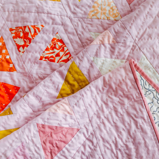 The perfect flower quilt pattern! The Perennial quilt pattern looks like wildflowers growing in a meadow – so use your scraps! Fat quarter and fat eighth friendly plus video tutorials! suzyquilts.com #FlowerQuiltPattern
