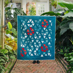The perfect Christmas quilt pattern! The Perennial quilt pattern looks like wildflowers growing in a meadow – so use your scraps! Fat quarter and fat eighth friendly plus video tutorials! suzyquilts.com #ChristmasQuiltPattern