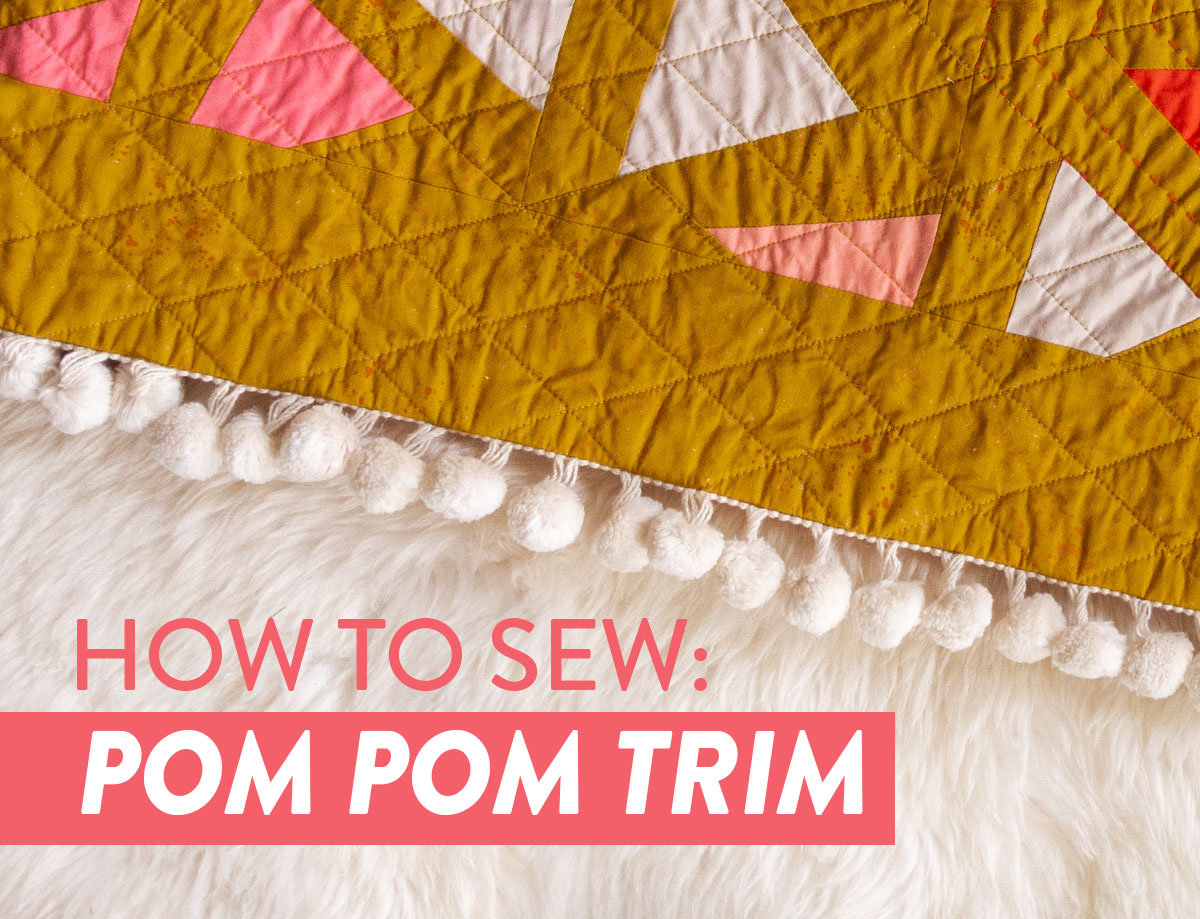 This tutorial will show you step by step how to sew pom pom trim to a quilt. Make your next quilt extra special with this easy sewing tutorial | suzyquilts.com #sewingtutorial #pompoms