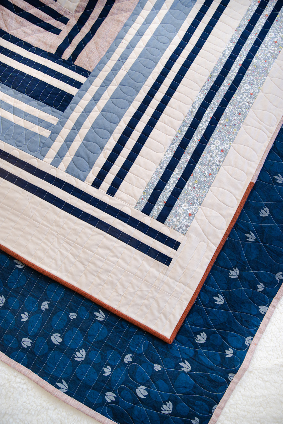 The Grow quilt pattern focuses on strip piecing – a simple quilting technique that creates a beautiful modern design. See lots of beautiful quilt examples! suzyquilts.com #quiltpattern