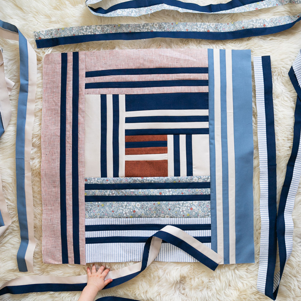 Join in on a fun community sew along! It is easy to participate. All you need is the Grow quilt pattern and to post your weekly progress as we make this quilt together! suzyquilts.com #quiltalong #sewalong