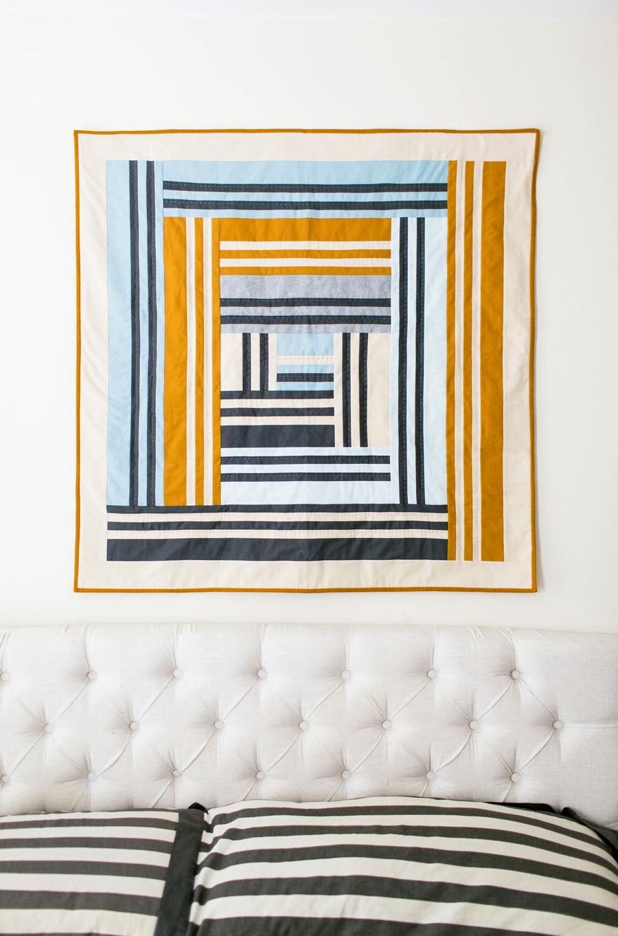 Grow is the first design in a series of four quilts that represent the four seasons in a year, as well as seasons in our lives. It includes fabric requirements and instructions for king, queen/full, twin, throw, and baby quilt sizes. This is an elegant modern medallion quilt. suzyquilts.com #babyquiltpattern