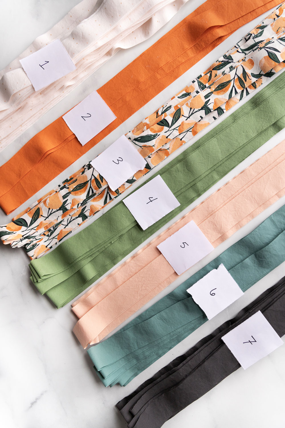 In weeks 3 and 4 of the Grow quilt sew along we sew our strips together into blocks. I have a great tip that will help you get perfectly flat seams that STAY in place. suzyquilts.com #quilting #quilttutorial