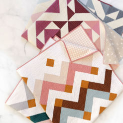 Thrive is a fat-quarter friendly modern quilt pattern. This instant PDF download comes in king, queen/full, twin, throw and baby quilt sizes. suzyquilts.com