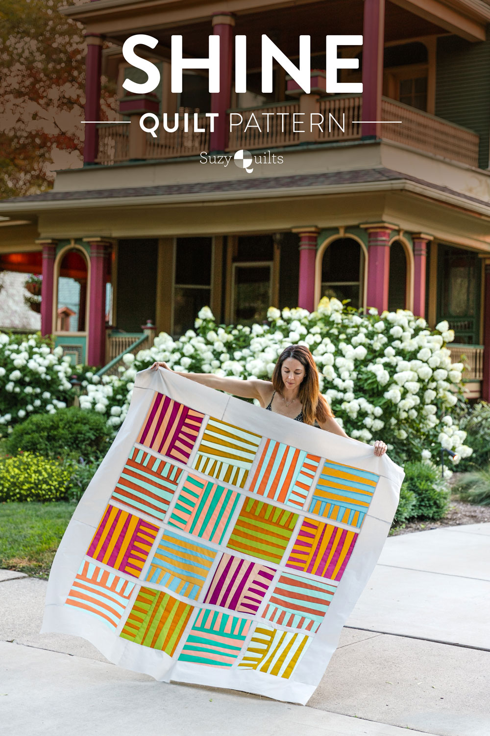 The Shine quilt sew along includes lots of added tips and videos to help you make this modern quilt pattern. This fat quarter quilt pattern is beginner friendly and focuses on improv sewing. suzyquilts.com #quiltedpillow #quilting