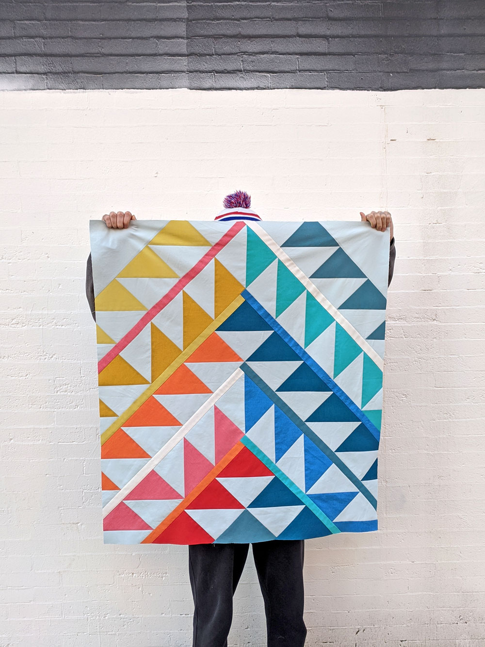 Gather is an HST modern quilt pattern with a unique twist! This instant PDF download comes in queen, twin, throw and baby quilt sizes. suzyquilts.com #quilt #babyquilt