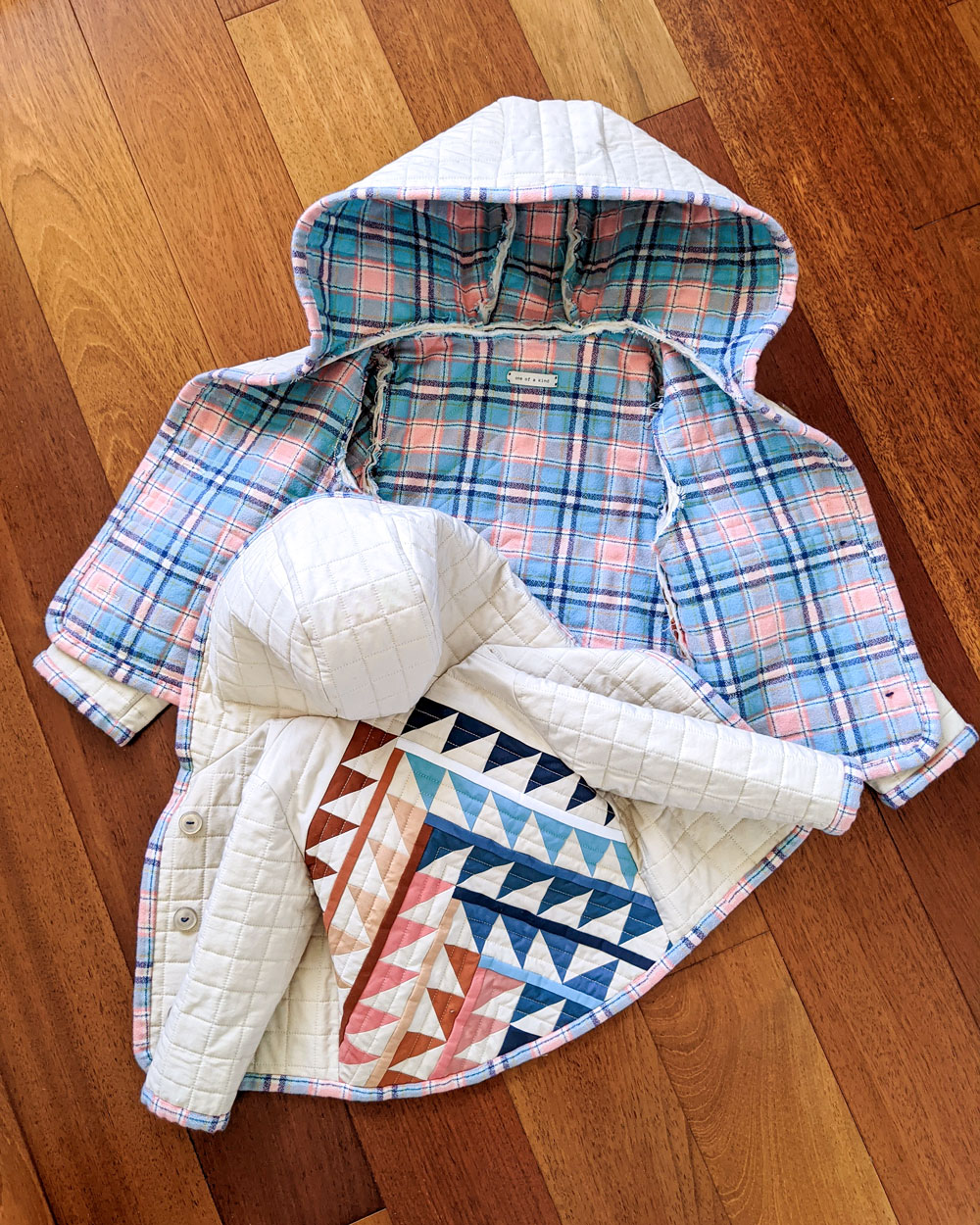 How to sew a quilted coat: tips on choosing fabric, a coat pattern and a quilt pattern plus tips on how to make your coat fit you! suzyquilts.com #quiltedcoat #sewcoat