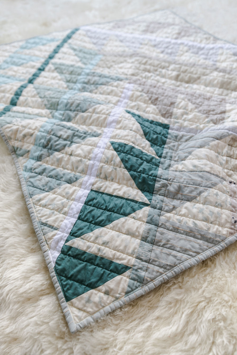Gather is an HST modern quilt pattern with a unique twist! This instant PDF download comes in queen, twin, throw and baby quilt sizes. suzyquilts.com #babyquilt