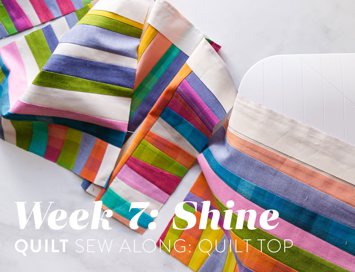 The Shine quilt sew along includes lots of added tips and videos to help you make this modern quilt pattern. This fat quarter quilt pattern is beginner friendly and focuses on improv sewing. suzyquilts.com #fatquarterpattern #improvquilt