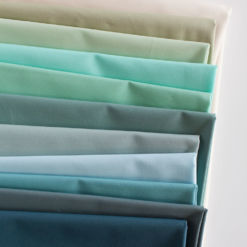 "Beautiful cool-toned fabric to make a 60"" x 72"" throw Voyage quilt. Made with 100% Art Gallery Fabrics PURE solids of the softest quality."