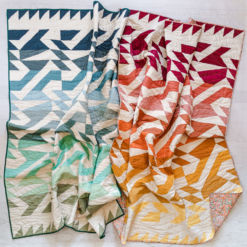 The Voyage quilt pattern is fat quarter friendly and a great quilt pattern for beginners! It includes king, queen, twin, throw and bay quilt sizes plus instructions for a two-color quilt version. suzyquilts.com